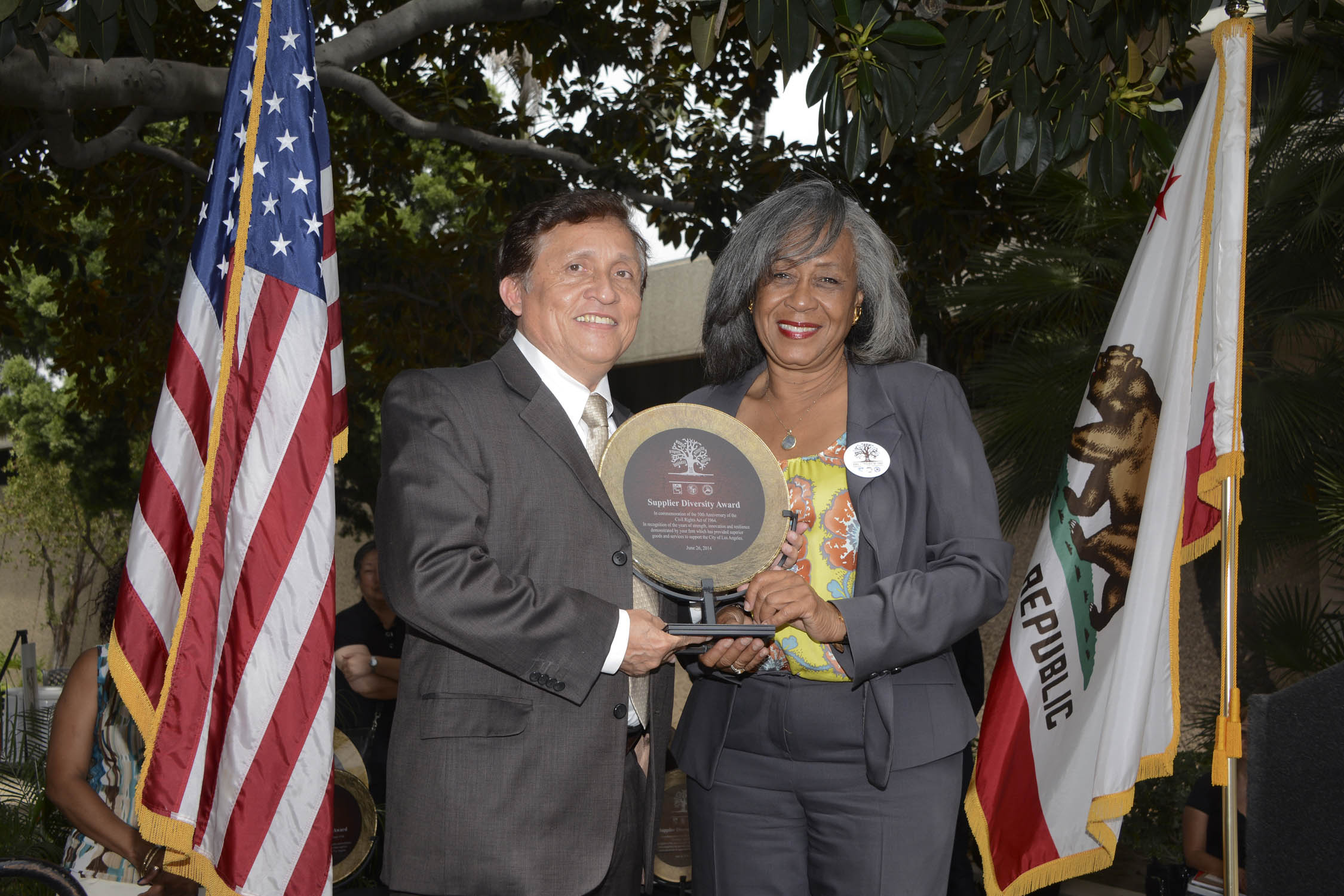 Victor M. Rojas in receipt of plaque, presented by LADWP's Director of Supply Chain Services, Gwendolyn W. Williams.